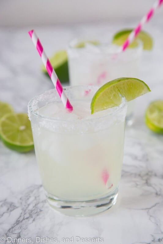 Classic Lime Margarita - a traditional lime margarita that is sweet, tart and super refreshing. Great for a party, with taco night, or just because! So easy to make you will make them every weekend!