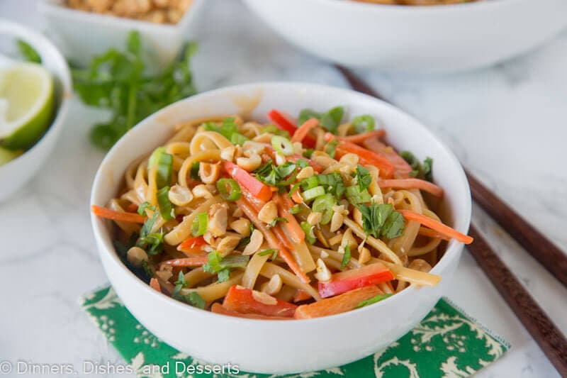 A bowl of noodles and vegetables on a table