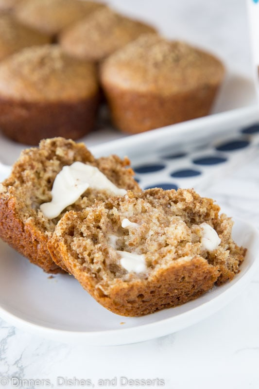 bran muffin on a plate with melting butter
