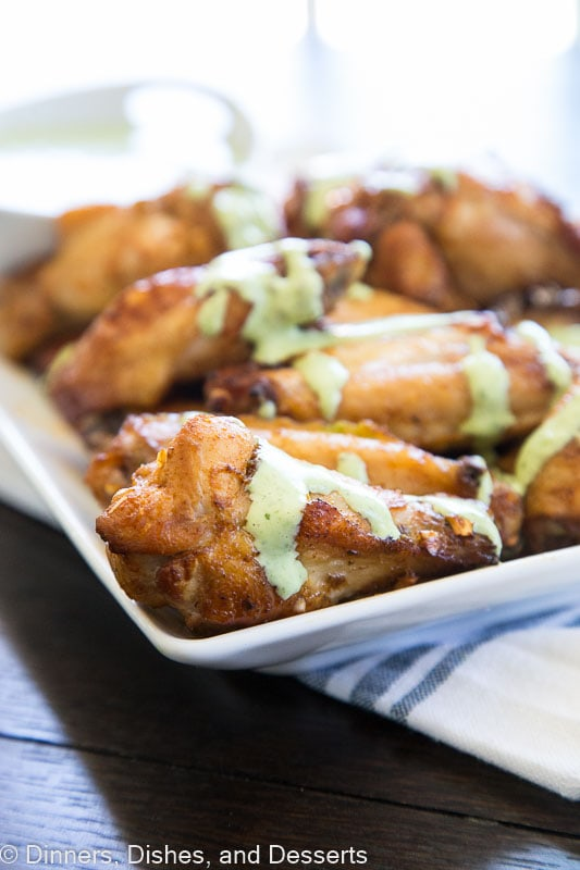 Baked Chicken Wings with Creamy Green Sauce - get the taste of Peru with these super easy chicken wing. Tons of seasoning and a creamy cilantro lime sauce for dipping!