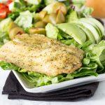 Garlic & Herb Mediterranean Salad - A crisp salad with fresh salad with garlic & herb tilapia and topped with a lemon garlic vinaigrette.
