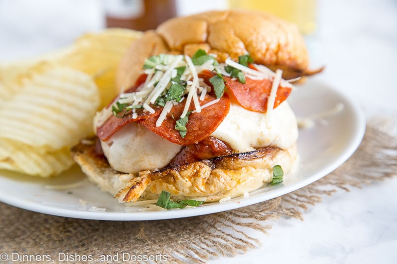 pepperoni pizza burger on a plate with potato chips