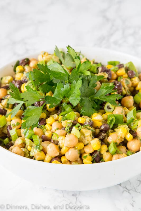 Southwestern Chickpea Salad - chickpeas and black beans with corn and avocado in a Southwestern style dressing. A great healthy and fresh summer side dish.