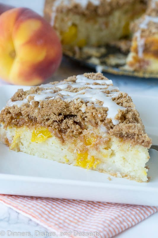 A piece of peach coffee cake on a plate
