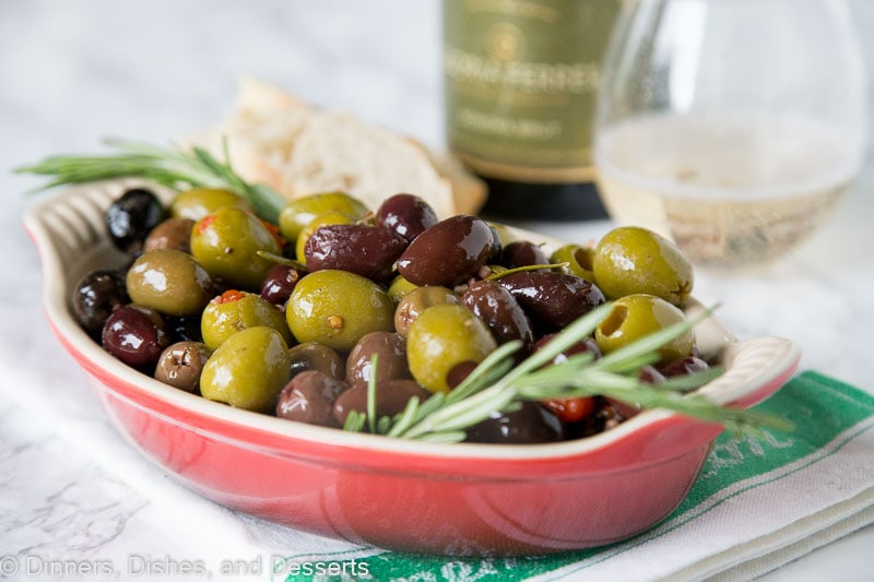Rosemary Roasted Olives - a mix of your favorite green and black olives tossed with olive oil, lemon and lots of rosemary. Perfect appetizer with your favorite wine.