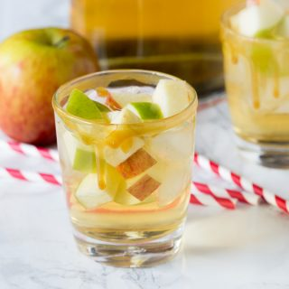 Caramel Apple Sangria - enjoy an easy sangria recipe that is perfect for fall.  Apple cider and caramel vodka make for a fun and fruity cocktail!