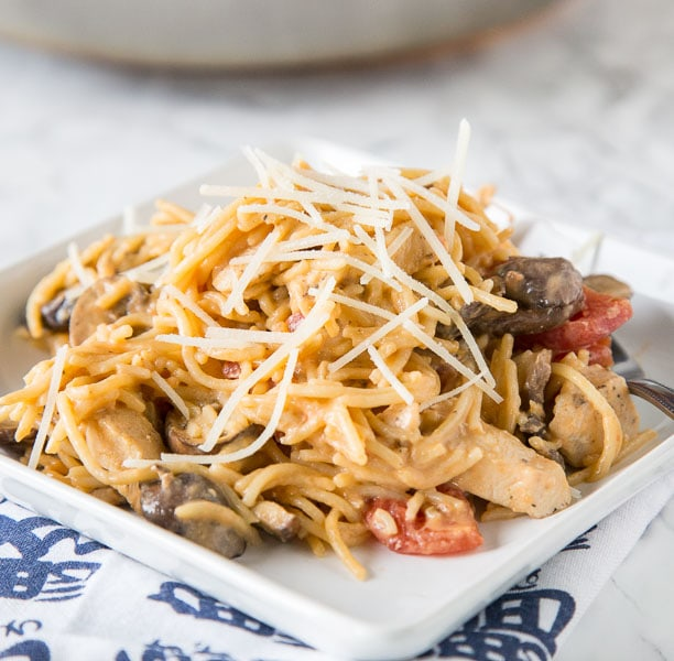 Creamy Tuscan Chicken Pasta - a super easy chicken pasta recipe that you can make any night of the week. Simple ingredients, just a few minutes, and dinner is done.