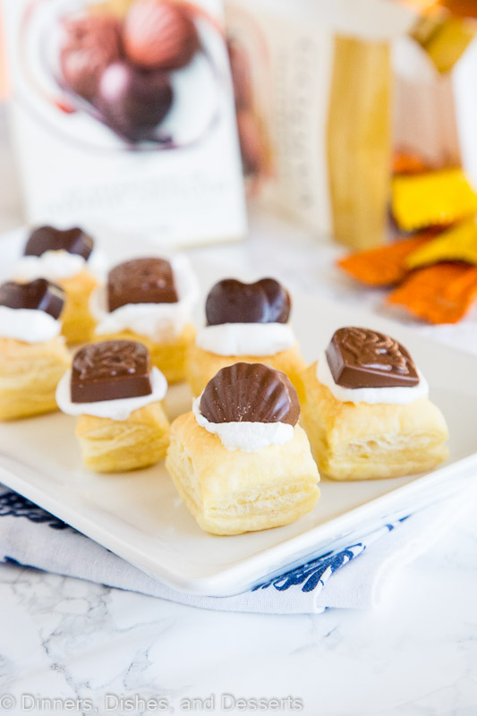 Chocolate Cream Puffs - these super easy little cream puffs are the perfect sweet treat. Flakey puff pastry, sweet cream, and GODIVA Masterpieces chocolate pieces to top it off.