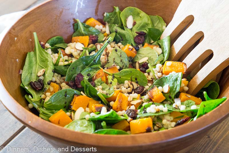 Fall Couscous Salad - Israeli couscous, spinach, butternut squash. cranberries and pecans all tossed with a balsamic vinaigrette. Great fall salad for the holidays, potlucks, or just because.