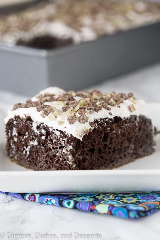 Irish Cream Chocolate Poke Cake - a tender chocolate poke cake spiked with Irish Cream and topped with whipped cream!