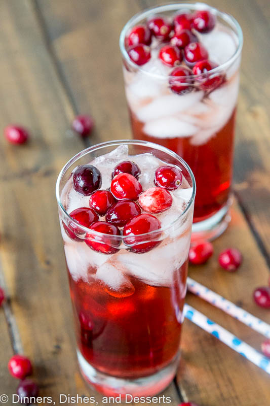Holiday Wine Spritzer Recipe - a fun cocktail that you can serve at all your holiday get togethers!  Wine, ginger ale, cranberry juice and cranberries make it festive and delicious!
