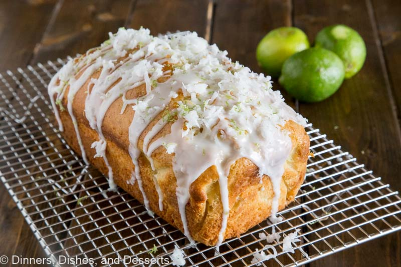 Loaf of coconut lime quick bread sitting on cooling rack