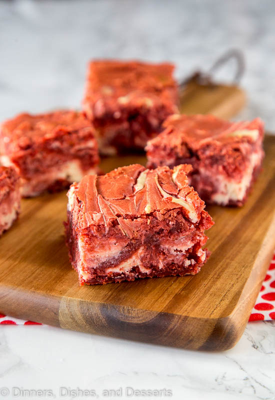 Red Velvet Brownies - thick and fudgy homemade browniesin a deep dark red color, swirled with cream cheese throughout.Red Velvet Cream Cheese Swirl Brownies look just as good as they taste!