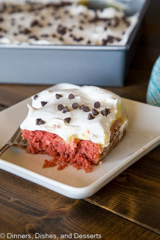 Beet Red Velvet Poke Cake - a red velvet cake made with beets instead of food coloring.  Topped with vanilla pudding and homemade whipped cream.  Decadent, tender, moist, and delicious!
