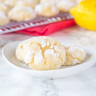 Lemon Crinkle Cookies -Made from scratch lemon cookies that are sweet and slightly tart.  Super soft on the inside with slightly crispy edges.