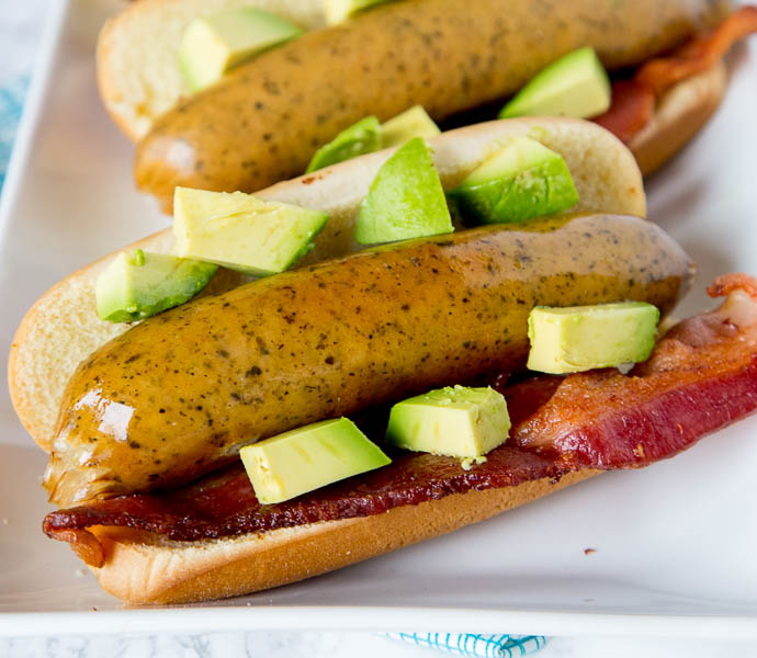 Bacon Avocado Beer Brats - Time to fire up the grill and make your brats extra special. Add bacon and diced avocado for a delicious twist!