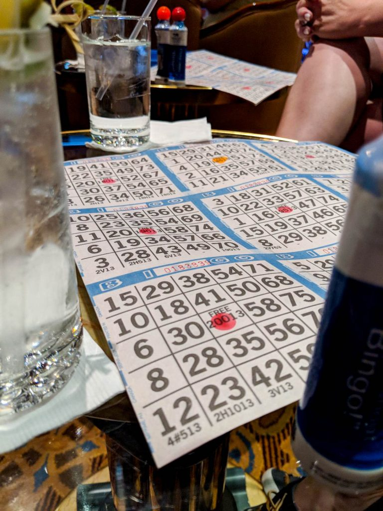 A person sitting at a table playing bingo