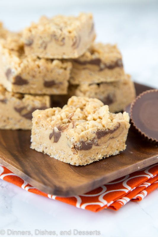 Peanut Butter Rice Krispie Treats - Classic rice krispie treats turned up a notch with lots of peanut butter, peanut butter fudge, and peanut butter cups!  No bake, super easy, and over the top amazing!