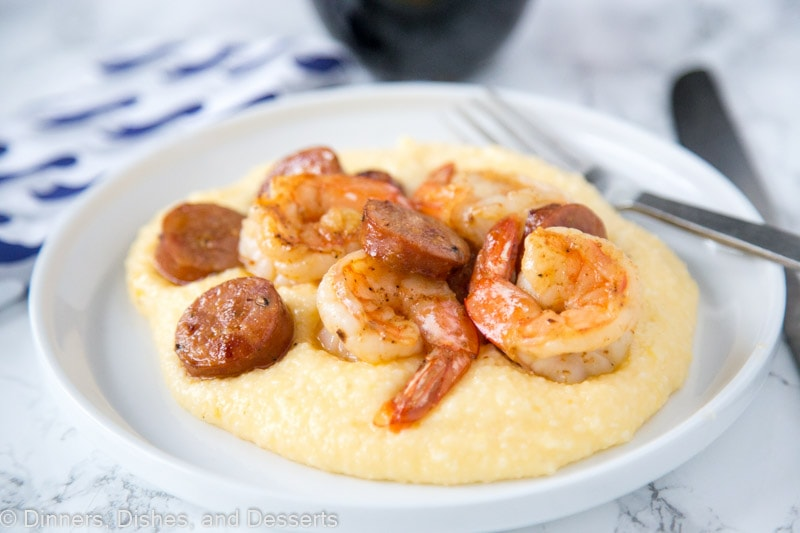 Shrimp and Grits Recipe - this easy shrimp and grits is ready in minutes and is perfect for busy weeknights.  Cheesy grits take it over the top, the whole family is going to love it!