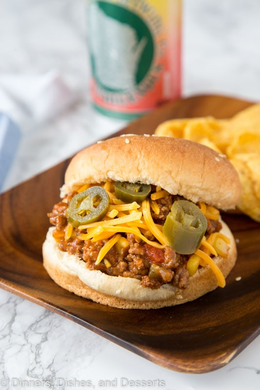 Taco Sloppy Joes - homemade sloppy Joes just got a Mexican makeover! Seasoned with taco seasoning, chilies and topped with cheese make them perfect for any night of the week!