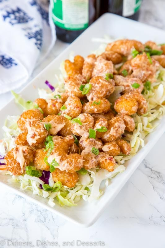 A plate of crispy fried shrimp with sauce