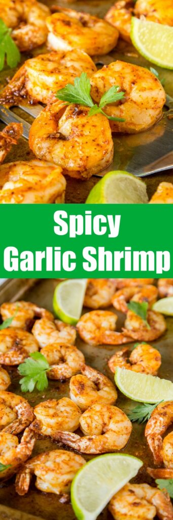 sheet pan of baked shrimp with lime wedges