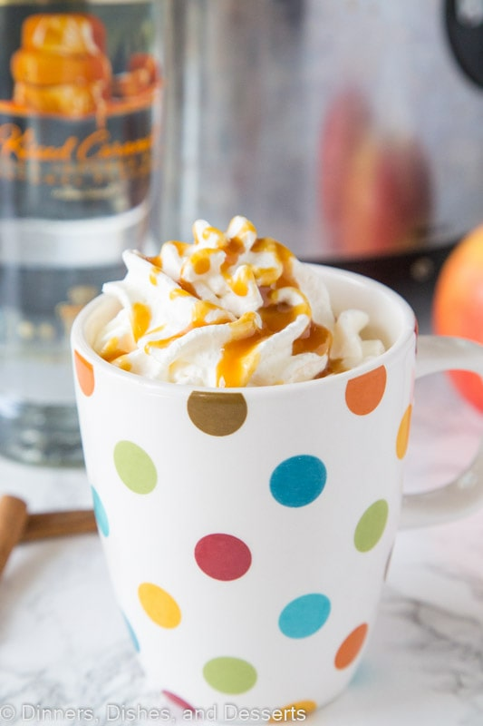 Spiked Hot Apple Cider - hot apple cider is a classic fall drink, this version is spiked with caramel vodka for a fun and delicious drink!