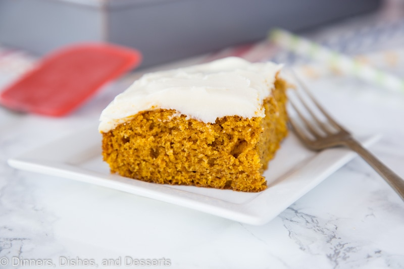 A piece of cake on a plate, with Pumpkin and Cream