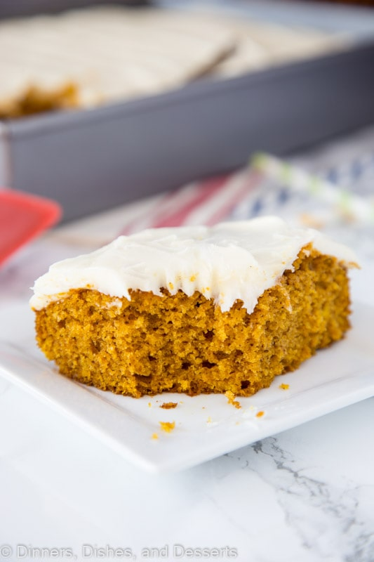 A piece of pumpkin cake sitting on top of a paper plate