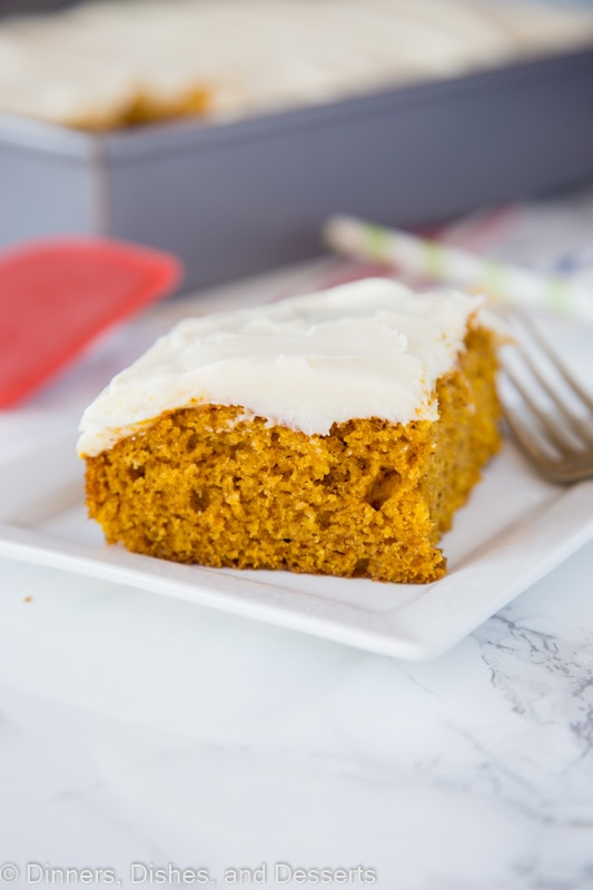 A piece of cake on a plate, with Pumpkin and Cream cheese