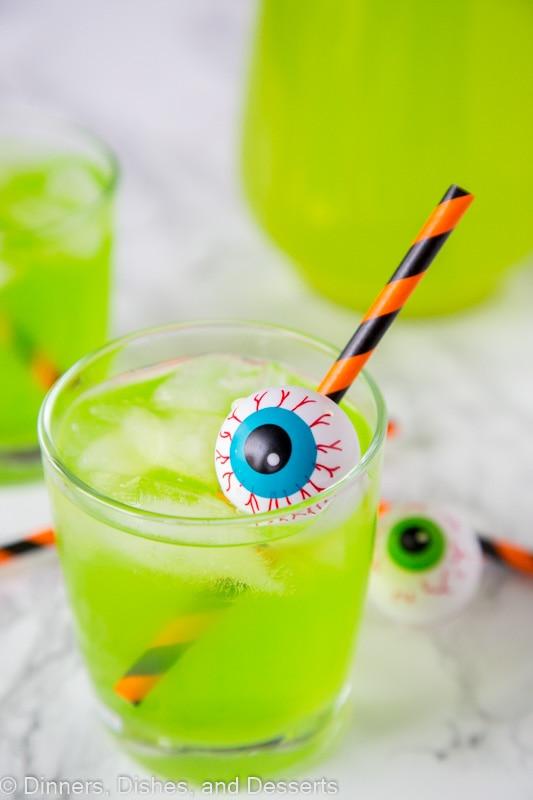 A cup of green Hawaiian punch with plastic eyeball for Halloween