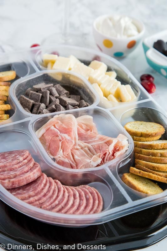 A plastic container filled with food, with Holiday and Mimosa