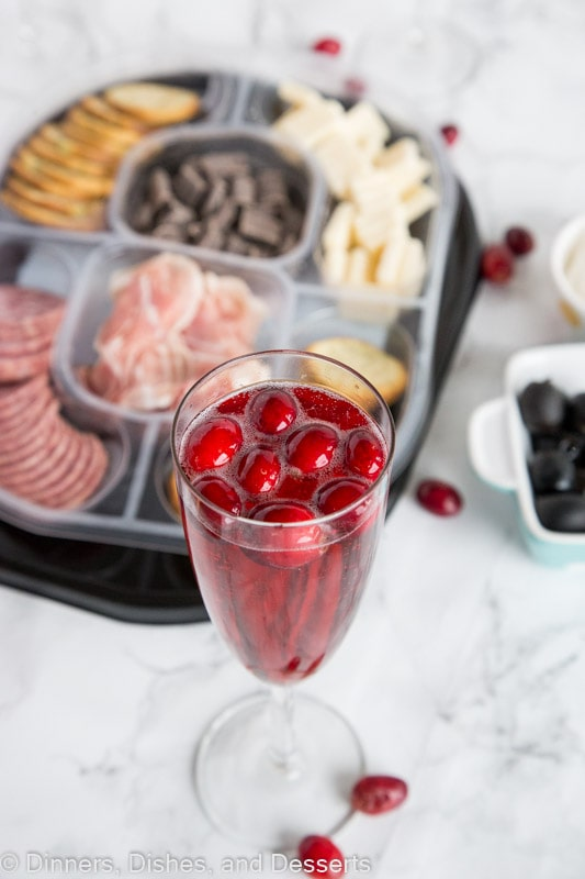 cranberry and wine next to tray of food