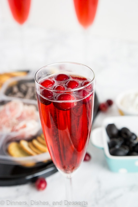 A close up of a wine glass, with Mimosa and Dinner