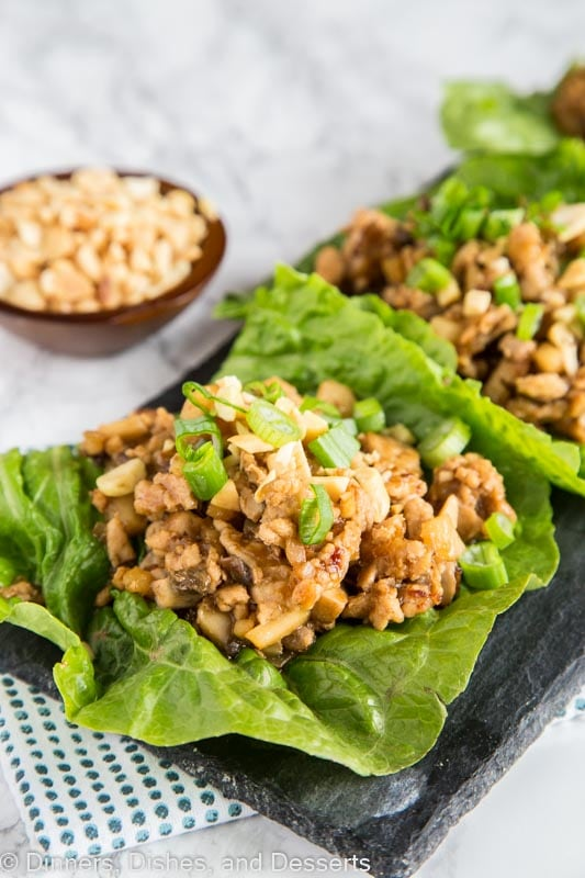 A plate of food with lettuce cups filled with chicken