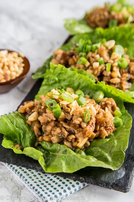 A dish is filled with food, with Lettuce and Wrap