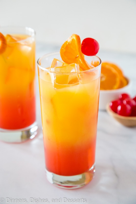 tequila sunrise with oranges and cherries
