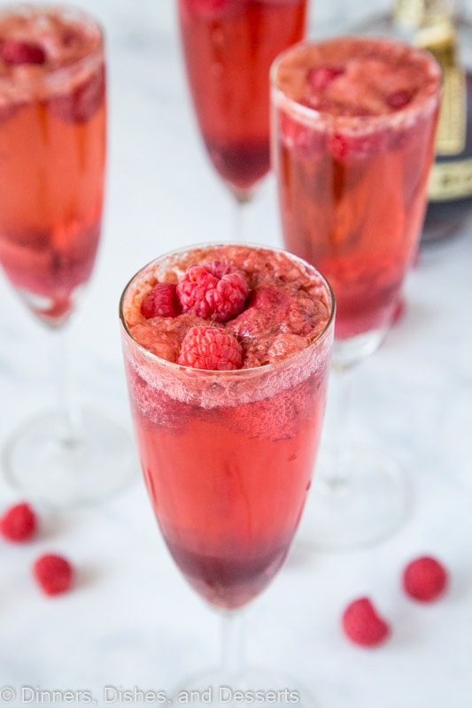Mimosas made with fresh raspberries, chambord, champagne and raspberry sorbet