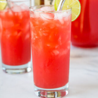 A close up of a glass of fruit punch, with Punch