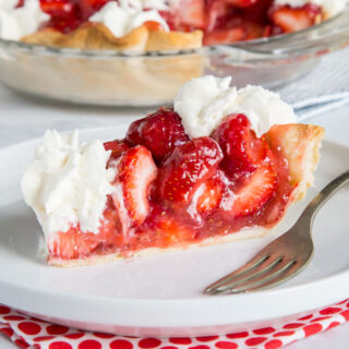 A slice of cake on a plate, with Pie and Strawberry