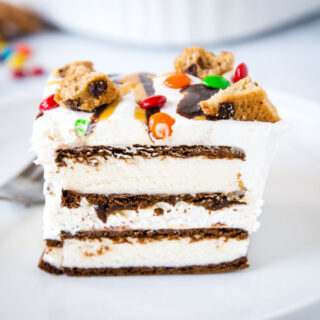 A close up of a slice of cake on a plate, with Cream