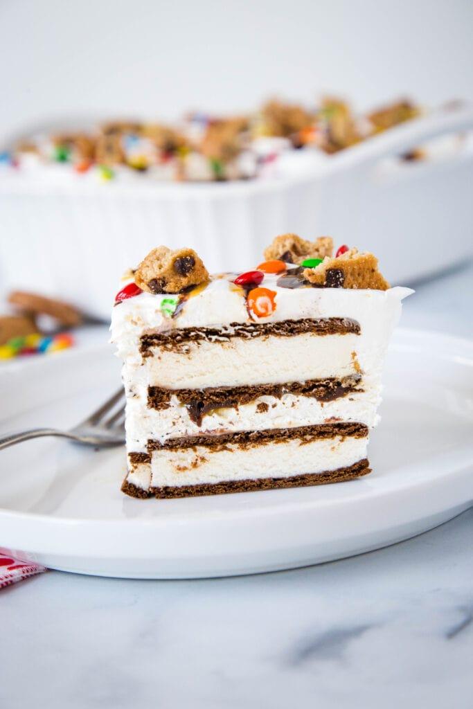 Ice cream sandwich cake with fresh whipped cream and topped like an ice cream sundae