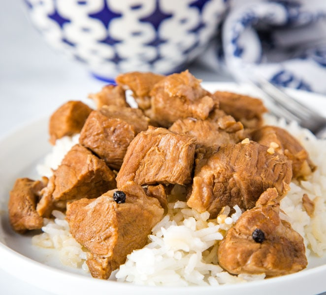 A plate of food with rice and meat