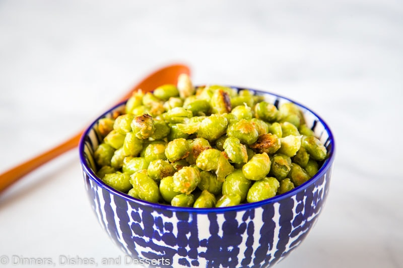 Parmesan Garlic Roasted Edamame - need a new way to get your kids to eat their vegetables?  These soy beans are roasted until crispy and coated in Parmesan cheese.  Great for picky eaters!