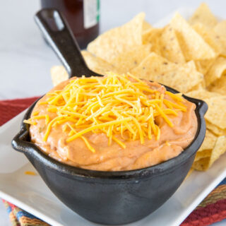 Easy Refried Bean Dip - this easy bean dip is super creamy, cheesy, and full of taco flavors.  This is always a hit at parties, and great for taco night.