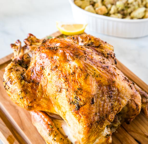 A close up of a plate with a whole roasted turkey with Dinner
