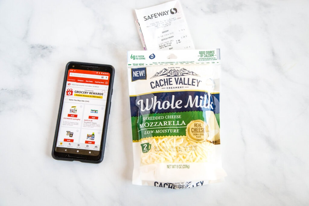 Safeway app on a phone with a bag of cheese