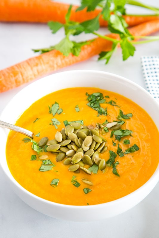 Easy soup recipe with carrots, ginger, garlic, and turmeric. Easy to make vegetarian or vegan.