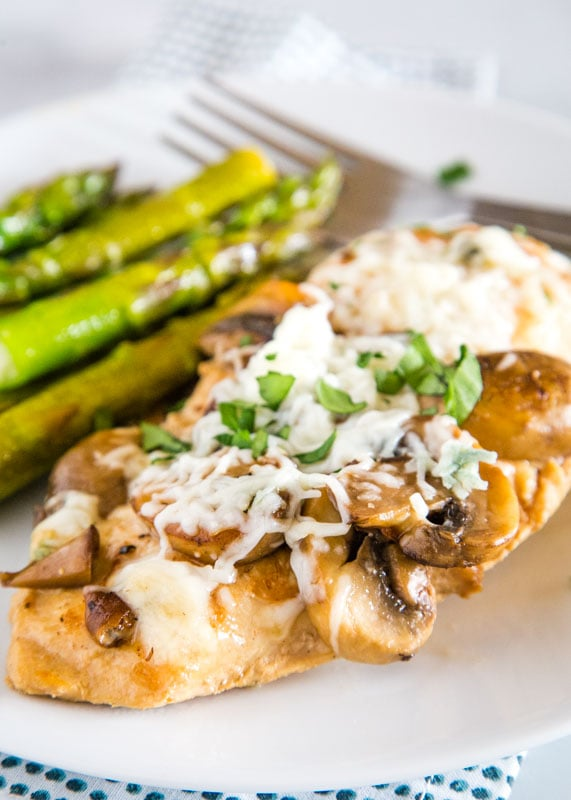Chicken in a mushroom madeira sauce and topped with melted cheese
