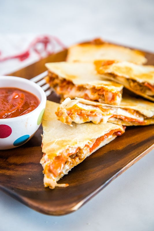 This easy Pizza Quesadilla is stuffed with whatever your favorite pizza toppings are!
